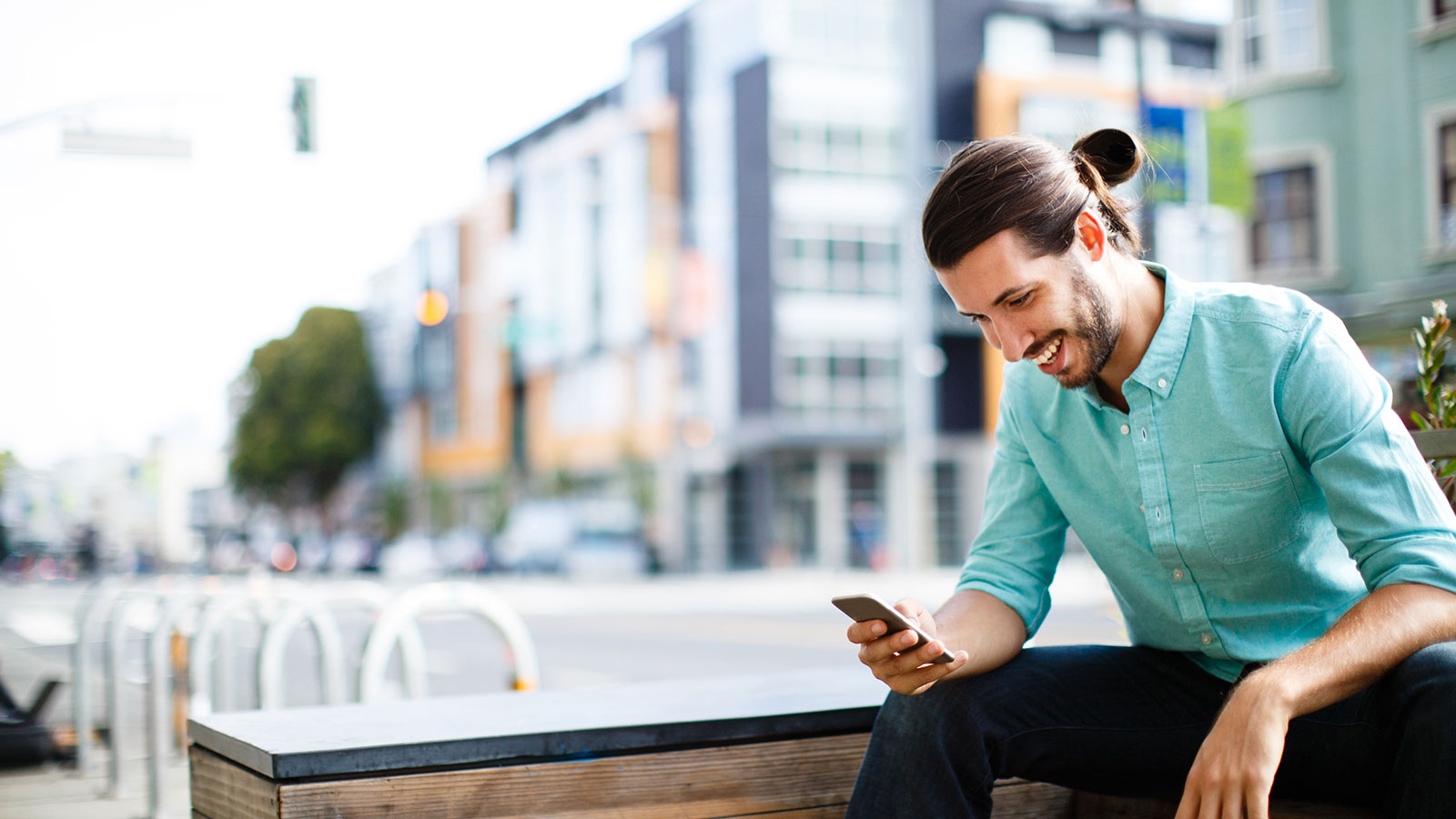 Person sitting on bench using phone